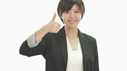 Asian businesswoman giving thumbs up Footage