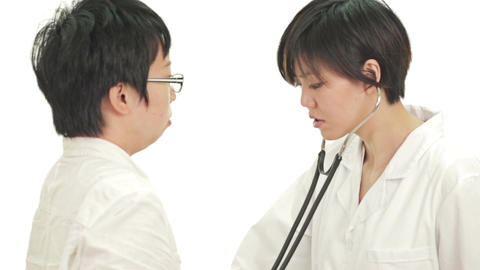 Patient Consulting Doctor And Getting Heartbeat Checked stock footage