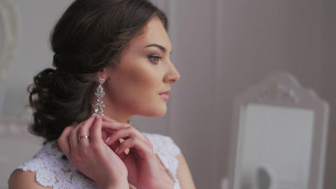 Elegant Brunette Bride Wear Beautiful Earrings stock footage