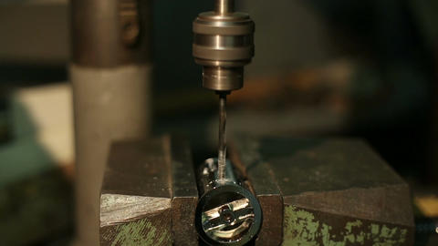 Man Drills A Detail On A Drilling Machine stock footage