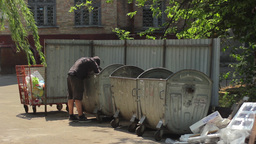 Beggar Homeless Man Digging In Trash stock footage