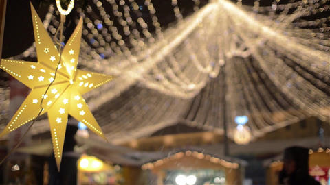 7-pointed yellow star lit at a Christmas fair over which is placed a dome 6 Footage