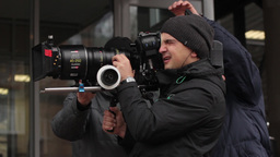 The Cameraman Shoots On A Professional Camera With Big Lens stock footage