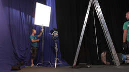 An Employee Of The Studio Movie Set Lighting Before Filming stock footage