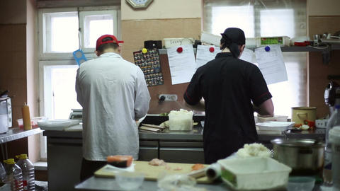 Two Chefs Cook In The Kitchen stock footage