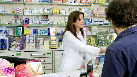 Pharmacist Selling Medicine To Client In Pharmacy stock footage