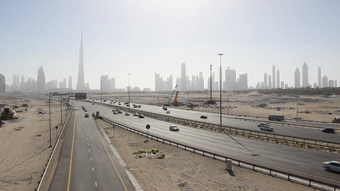 Iconic Dubai Cityscape From Desert Area, Road Traffic Lead To Downtown stock footage