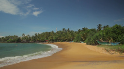 Empty wide sandy shore of a tropical island . Sri Lanka Footage