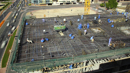 Workers Prepare Rebar And Align Communication Structures Before Concrete Pouring stock footage