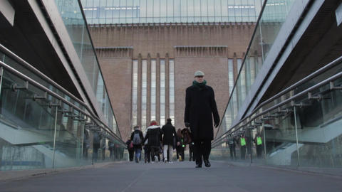 Millenium Bridge Walking Man stock footage