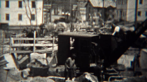 1939: Steam Shovel Construction Crane Moving Concrete After Disaster stock footage