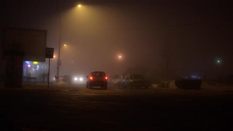 Car Traffic At Night On A Misty Street In December 80 stock footage