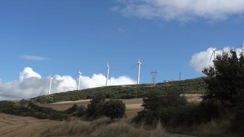 Collection Of Rural Wind Turbines. Wind Turbines Seen In The Distance On A Hill  stock footage