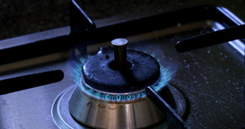 Turn On The Burning Gas Stove In The Kitchen At Blue Fire stock footage