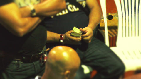 Unidentified High Stakes Gambler Counting Dollars At Cockfight Event stock footage