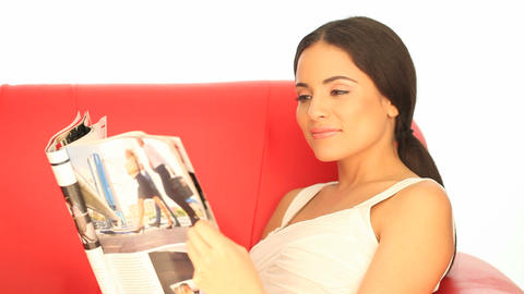 Woman Reading A Magazine On A Sofa stock footage