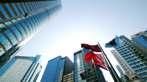 Hong Kong And China Waving Flags At Central City Square Among Modern Skyscrapers stock footage