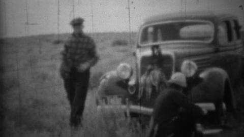 1936: Hunting prairie chickens husband wife quality time together Footage