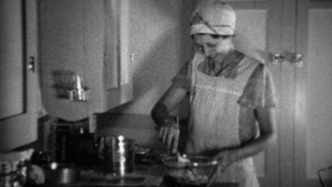1936: Aproned Women Cooking In Kitchen Sifting Flour For Biscuits stock footage