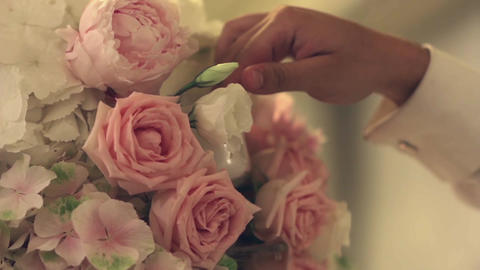 Hand Man Arranges A Candle In A Beautiful Bouquet Of Roses Located On A Meal 29a stock footage