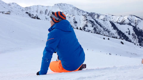 Young Man Sitting At Snow In Ski Resort stock footage