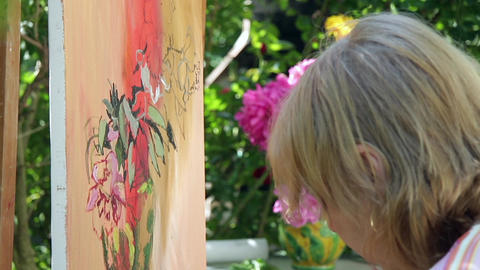 Painter Draws In Oil Colors're A Bunch Of Peonies In A Vase On The Table Beside  stock footage