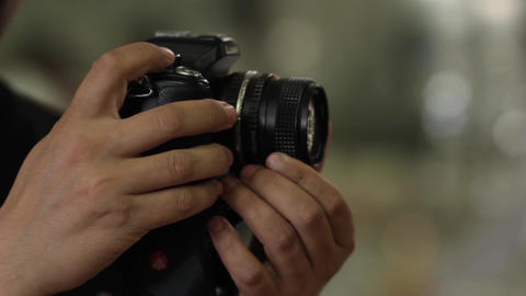 Photographer Is It That Spins The Ring Focus Of A Lens 00 stock footage