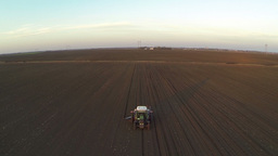 Aerial Shot Of Tractor Working In The Field stock footage