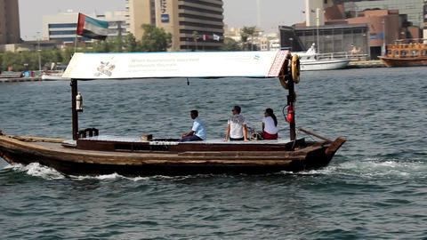 Tourist couple ride with driver at rented Abra boat, small wood vessel sail Footage