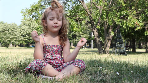 Little Girl Meditates stock footage
