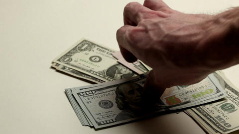 Hand Putting Dollar Bills stock footage