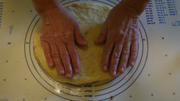 Female Hands Stretching A Pie-like Dough Meal stock footage