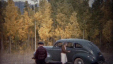 1940: Light blue sedan car parked in autumn yellow colors forest Footage