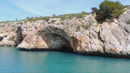 The East Coast Of Mallorca Island Red Cliffs And Caves Seen From A Boat stock footage