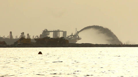 Land reclamation, trailing suction hopper dredger stream silhouette Footage