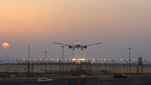 Airliner Landing At Airport, Desert Sunset View, Straight Runway Perspective stock footage