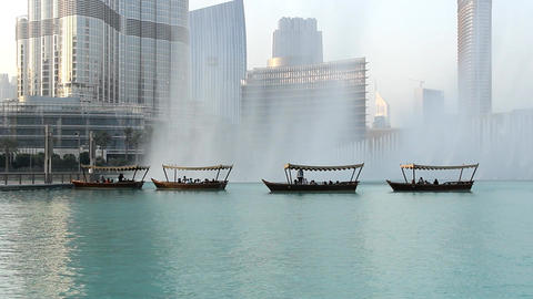 Pleasute boats with people observe music fountain, stand in line against water Footage