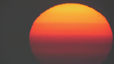 Incandescent red orb of the sun at sunrise 15 Footage