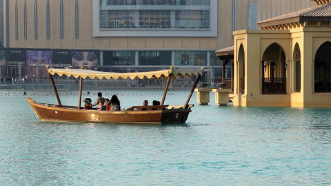 Water Taxi, Pleasure Boat At Burj Khalifa Lake. Telephoto View, Vessel Sail Away stock footage