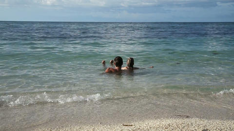 Father And Daughter In The Tropical Sea stock footage