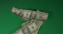 Dollar bills are falling down one by one Footage