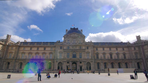 Louvre Building With Tourists And Blue Sky Pan stock footage