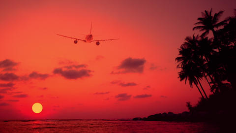 Airplane flying over amazing sunset landscape with tropical island. Thailand Footage