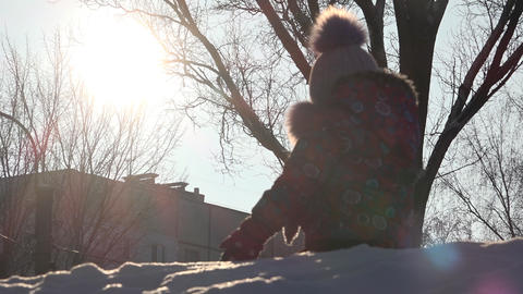 Cute Child Playing In Snow In Winter. Sunny Day stock footage