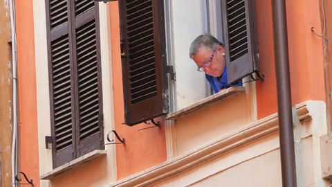 ROME - ITALY, AUGUST 2015: Italian Woman Looking From Window stock footage