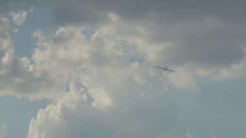 The glider floats in the air among the clouds and follows the wind Footage