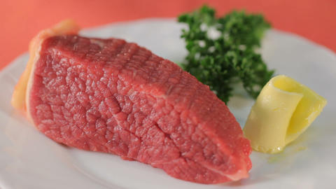 Fillet Of Raw Meat, Green And Butter On White Plate stock footage