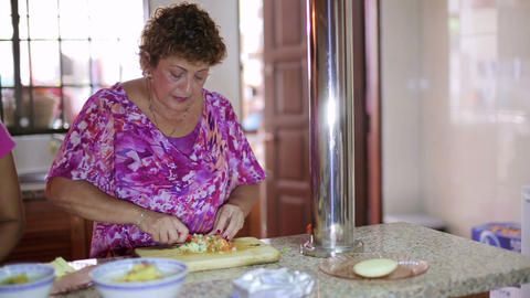 Mother Preparing Food At Kitchen stock footage