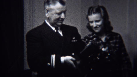 1944: Military general inspects modern film projector technology device Footage
