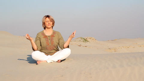 woman meditating in desert Footage